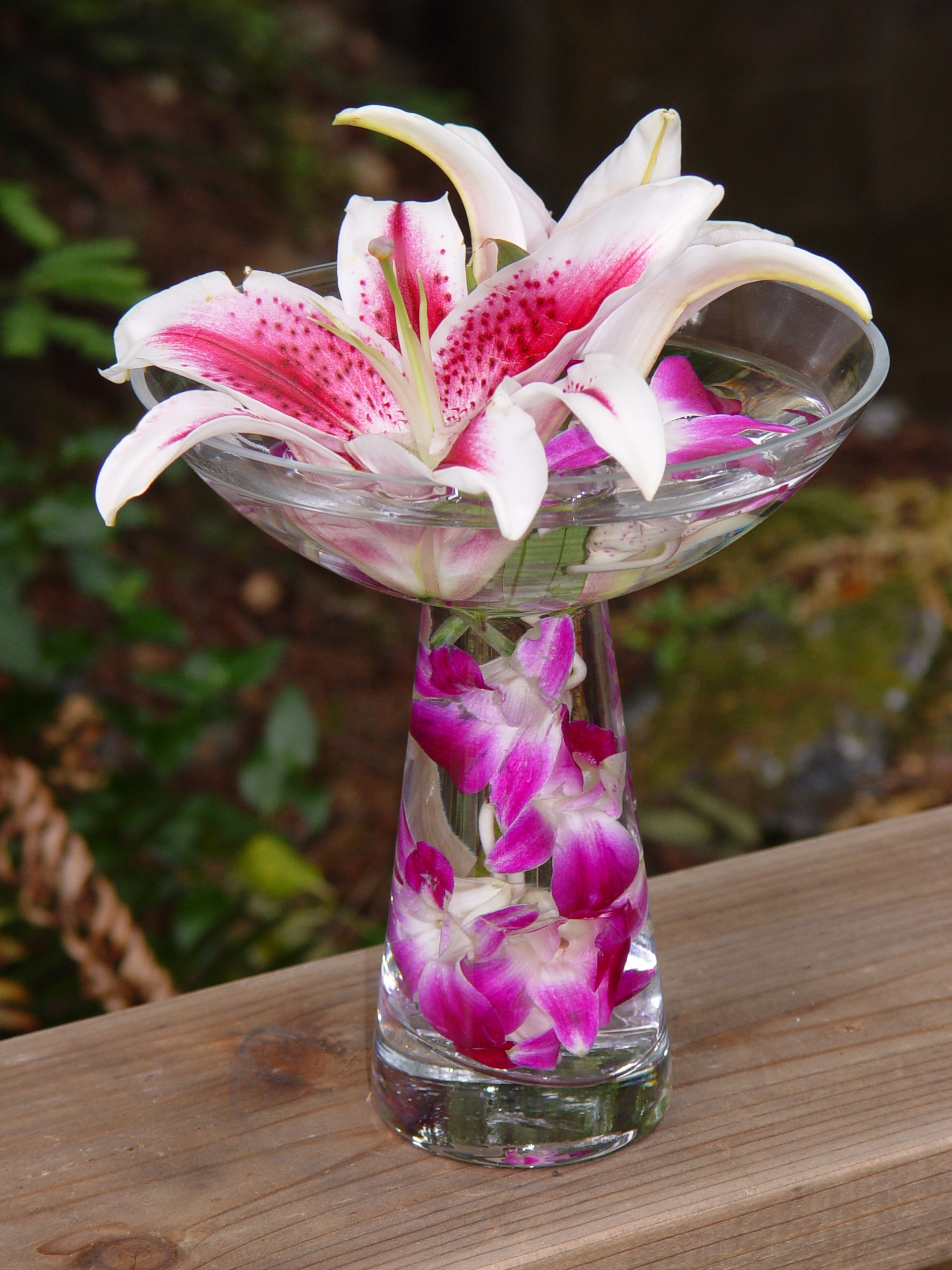 A unique glass vase filled with submerged dendrobium