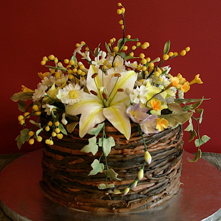 Basket cake realistic sugar flowers planted in a