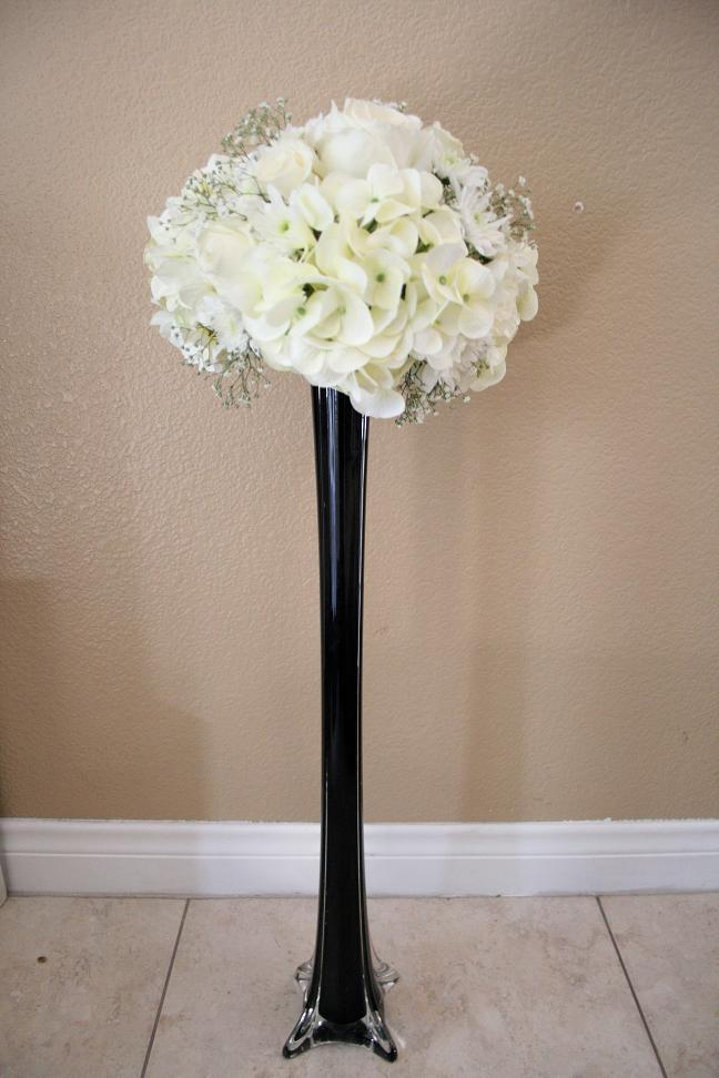 Tall tower vase centerpiece with hydrangea roses