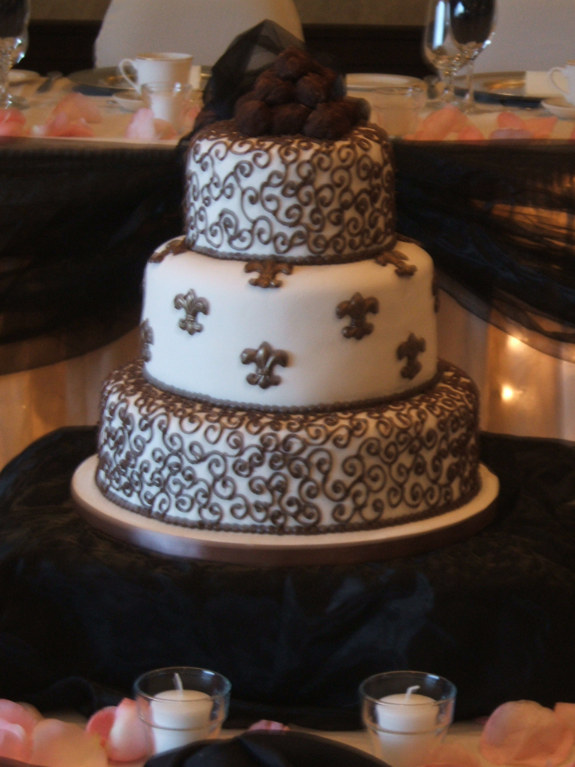 Rich Chocolate Truffle Cake With Chocolate Fleur De Lys And Real French Truffles On The Top