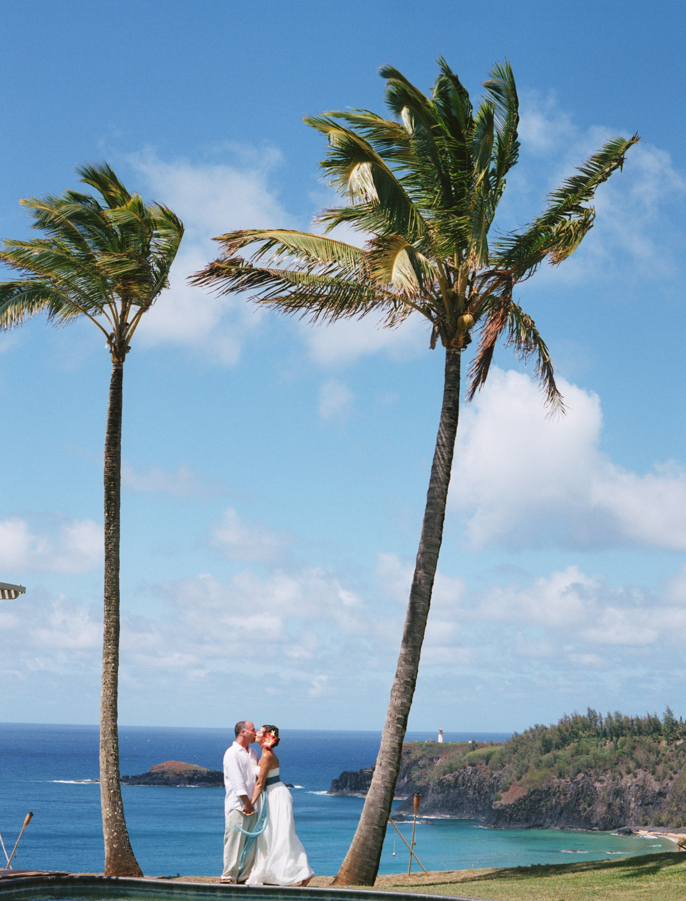 Destinations, orange, blue, Destination Weddings, Hawaii, Beach, Wedding, Colorful, Destination wedding, Palm trees, Kissing couple, Hawaiian wedding, Kuaui
