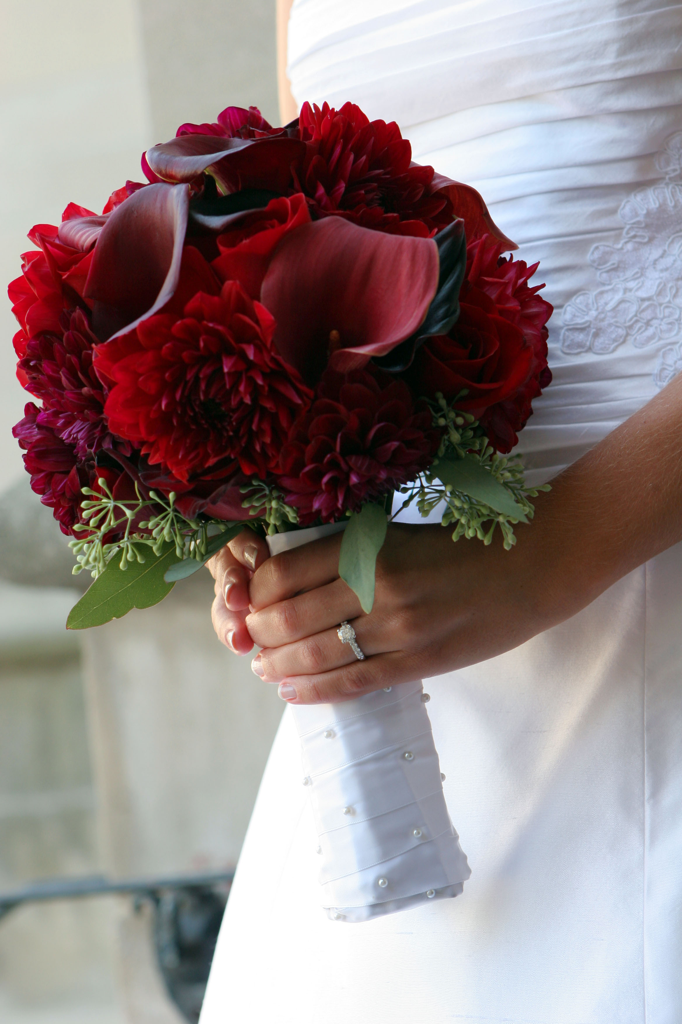 Bouquet by just bloomed red roses dahlias and calla lilies