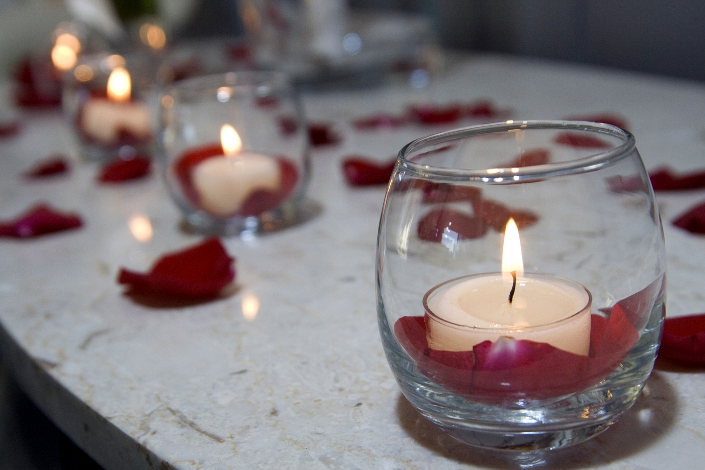 votive candle holders with red rose petals in the bottom. Black Bedroom Furniture Sets. Home Design Ideas