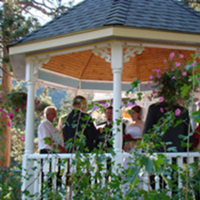 Outdoor ceremony in wedding gazebo