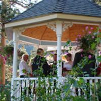 Outdoor ceremony in wedding gazebo