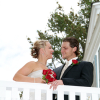 Balcony photo of bride and groom