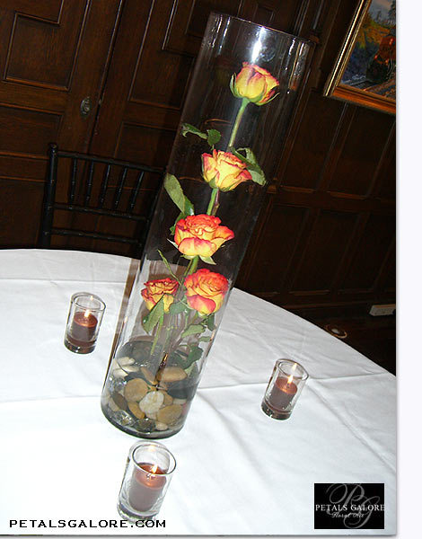 Reception, Flowers & Decor, Centerpieces, Candles, Flowers, Submerged, Stones, Vase glass, Color yellow, Flower rose, Vendor petals galore, Vase cylinder, Color orange