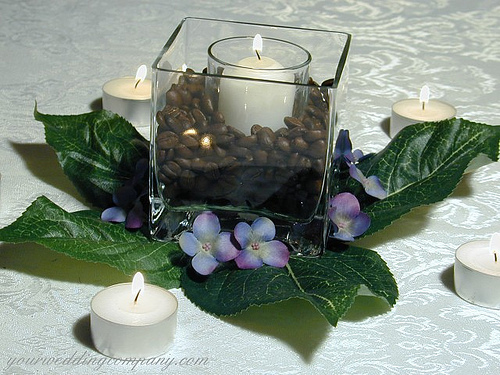 Coffee bean and candle centerpiece with hydrangea flower