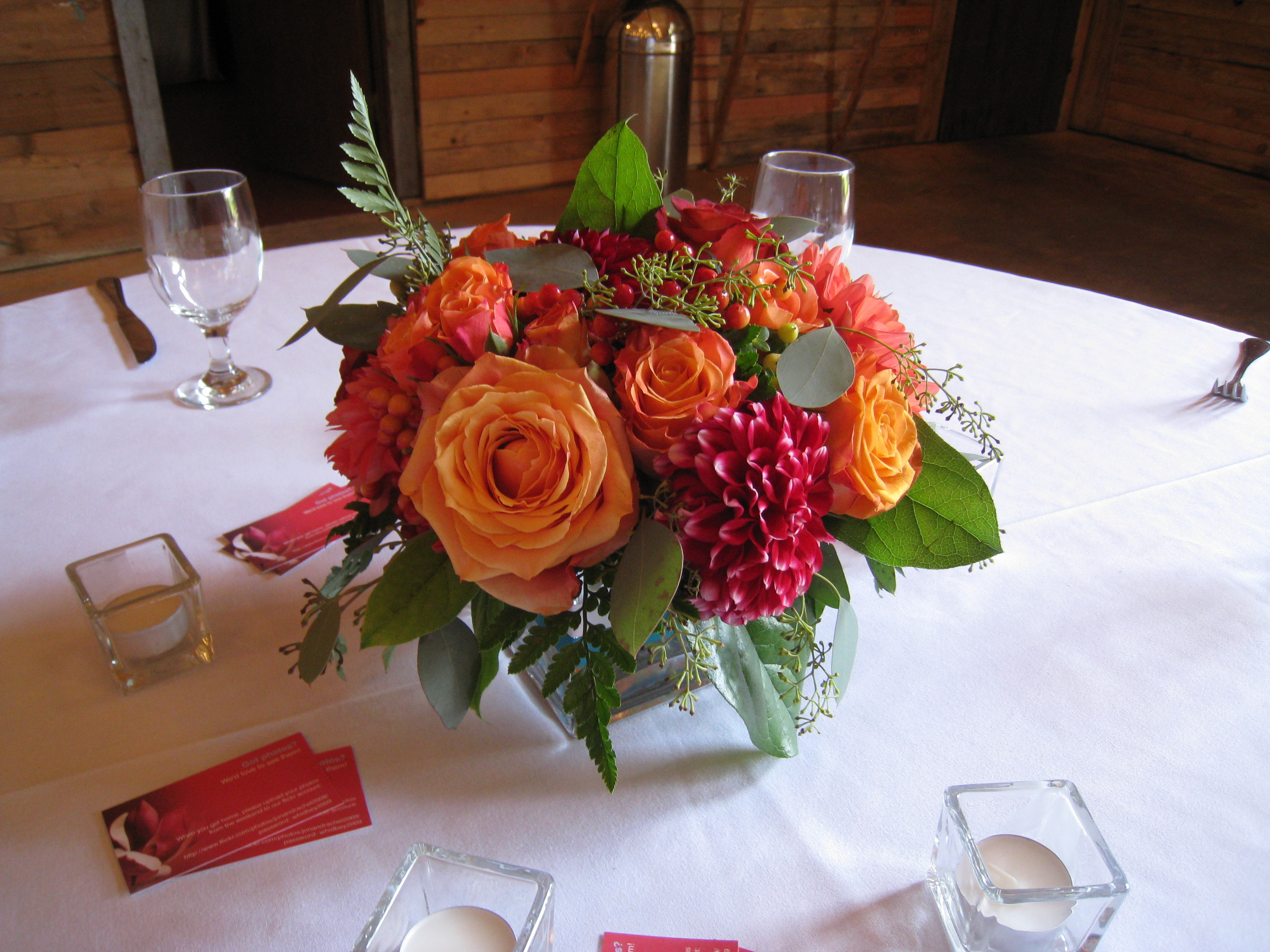 Centerpiece with mixed dahlias and rosesvendors designs by