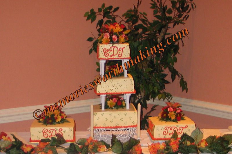 Flowers, cake, white, green, red, orange, brown, Wedding, black, yellow, gold, Fall, Square, Monogram, Floral, Pearl, Buttercream, Stacked, Autumn, Leaves, Leaf, Glitter, Layer, A memory worth making - cakes, Glitz, Satellite, Cakes, Monogrammed Wedding Cakes, Flowers & Decor, Fall Wedding Flowers & Decor, Square Wedding Cakes