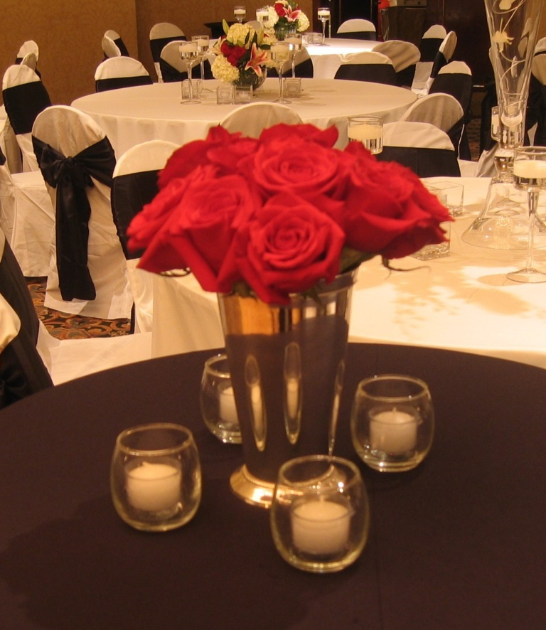 Cocktail hitops accented with red roses in silver vases and votive candlesvendors the silver - Red and silver centerpiece ideas ...