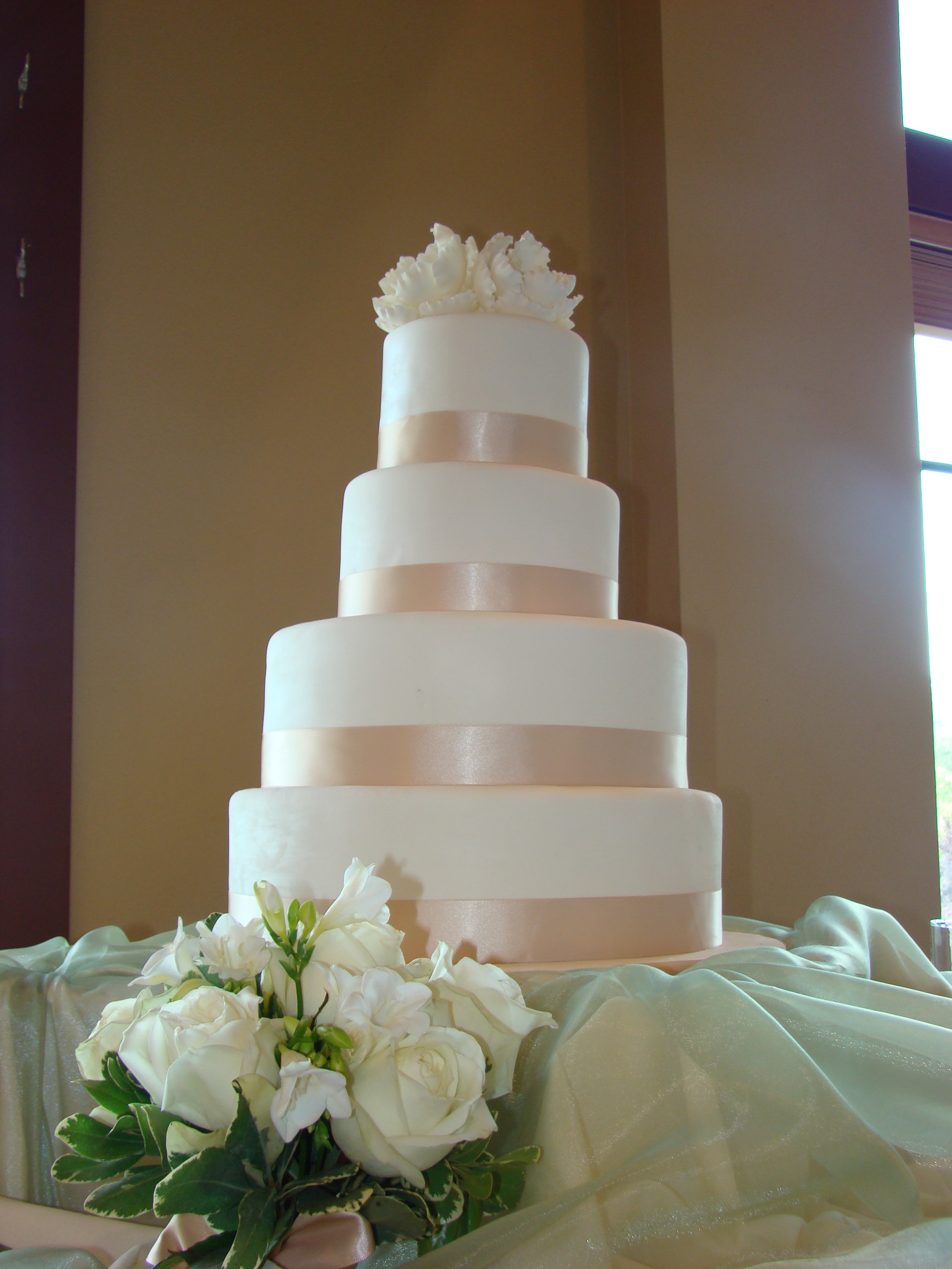 4 tier simple and elegant white fondant cake with a