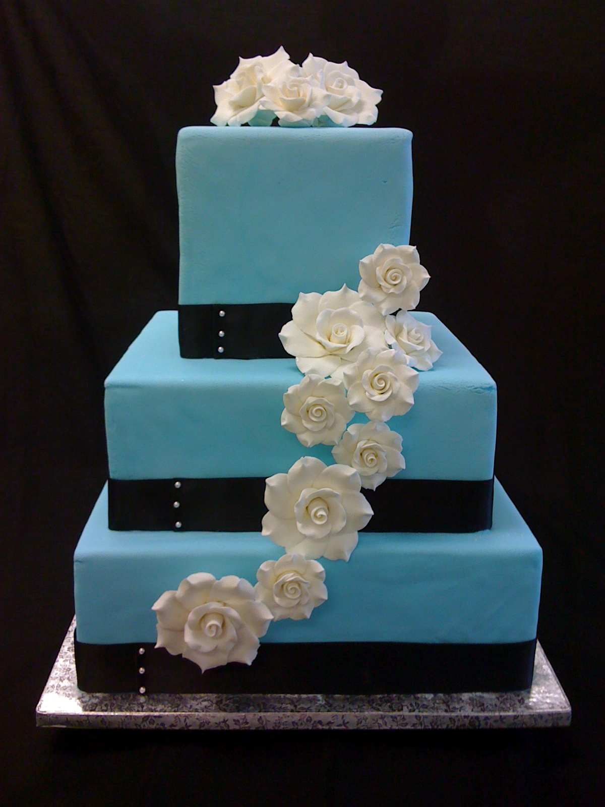 gardenias adorn a baby blue wedding cake with black ribbon and pearl accentsvendors occasionally. Black Bedroom Furniture Sets. Home Design Ideas