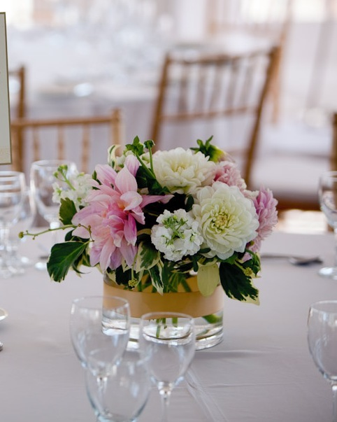 Low lush centerpiece in soft creams pinks and greens