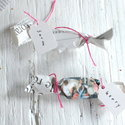 1375152456_thumb_1367352327_content_diy_newspaper-wrapped-candy-favors_6