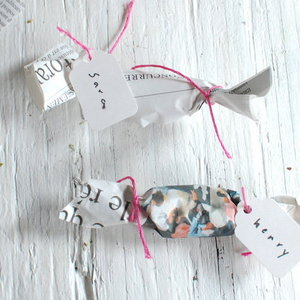 1375582272 photo preview 1367352327 content diy newspaper wrapped candy favors 6