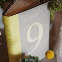 Flowers & Decor, Stationery, Real Weddings, Wedding Style, yellow, gray, Table Numbers, Rustic Real Weddings, West Coast Real Weddings, Eco-Friendly Real Weddings, Eco-Friendly Weddings, Rustic Weddings, Rustic Wedding Flowers & Decor, Vintage Wedding Flowers & Decor, Books