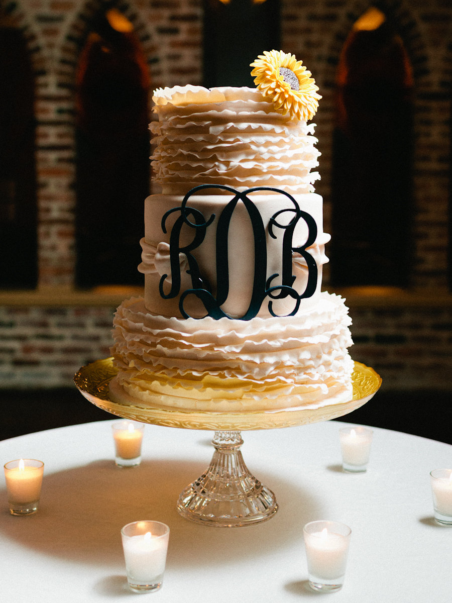 the cake was an absolute confectionary masterpiece ruffles an elegant monogram and a sunflower. Black Bedroom Furniture Sets. Home Design Ideas