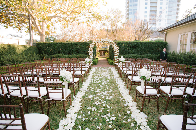 the ceremony loose flower petals line the path to a lovely floral arch photo by nancy aide. Black Bedroom Furniture Sets. Home Design Ideas