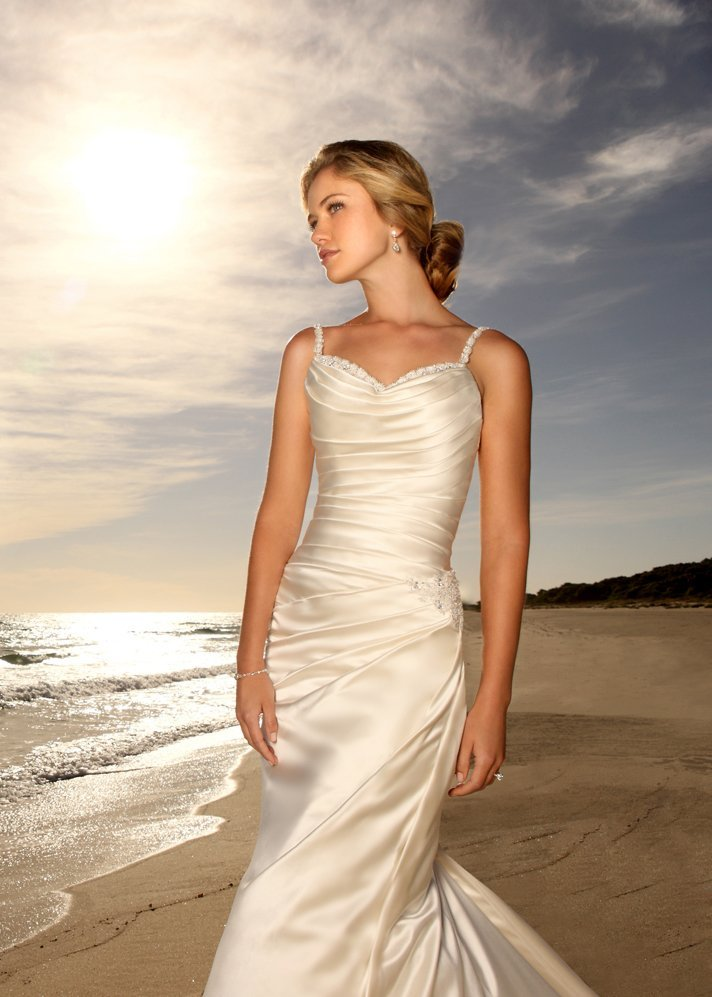 Dramatic slimline designer angel satin gown is ruched for Chic modern wedding dresses