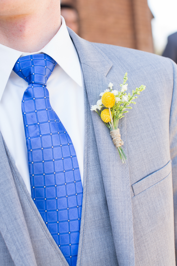 each groomsman wore a different cobalt blue patterned tie