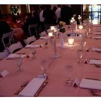 Peach tablecloths and lace covered candles
