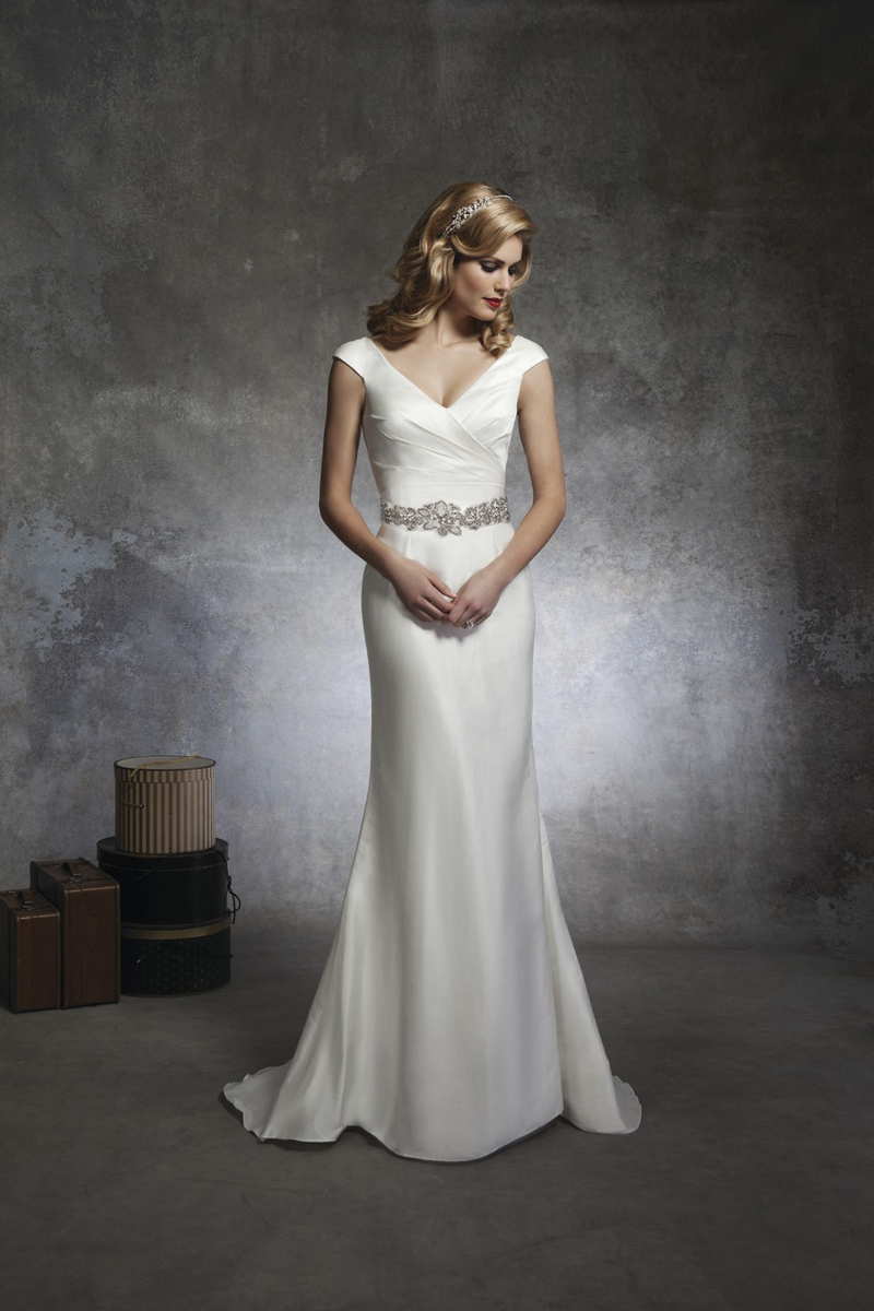 This soft trumpet style has a vneck draped in silk dupion for V neck satin wedding dress