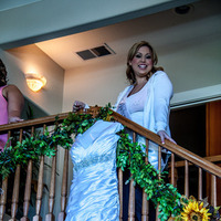 Bride In front of bridal gown