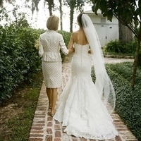 mother walking bride down aisle