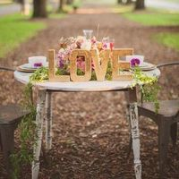 """Love"" Sign Sweetheart Table"