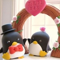 Groom and bride penguins with flower arch Wedding Cake Topper