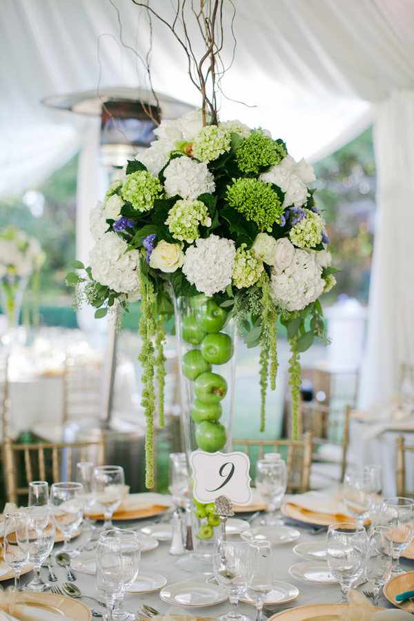 The tall reception centerpieces were placed in vases