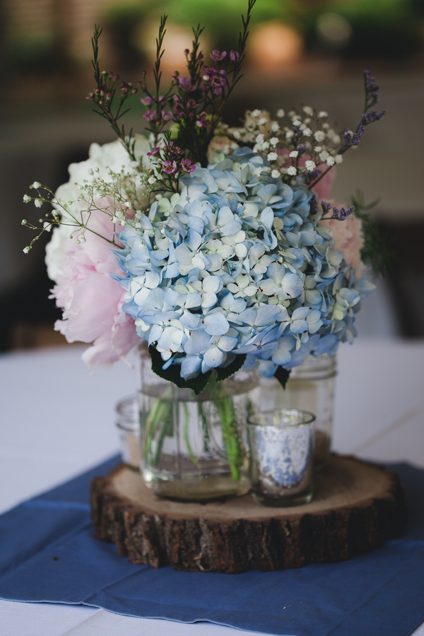 The centerpieces featured blue hydrangeas pale pink