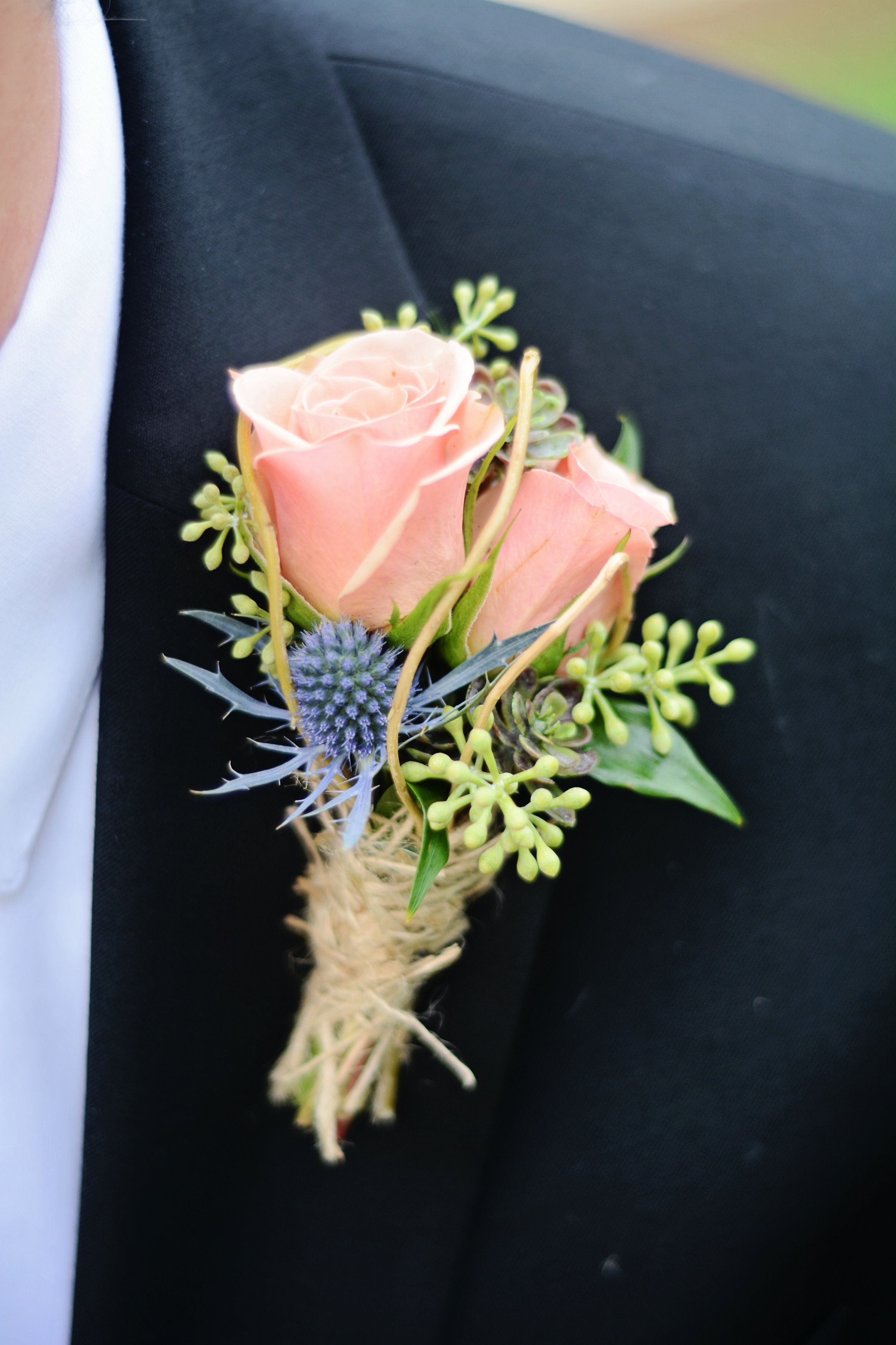 Terrance wore a boutonniere of peach roses blue thistle ...