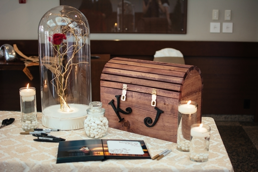 The welcome table featured a photo album guest book a treasure – Wedding Treasure Chest Card Box