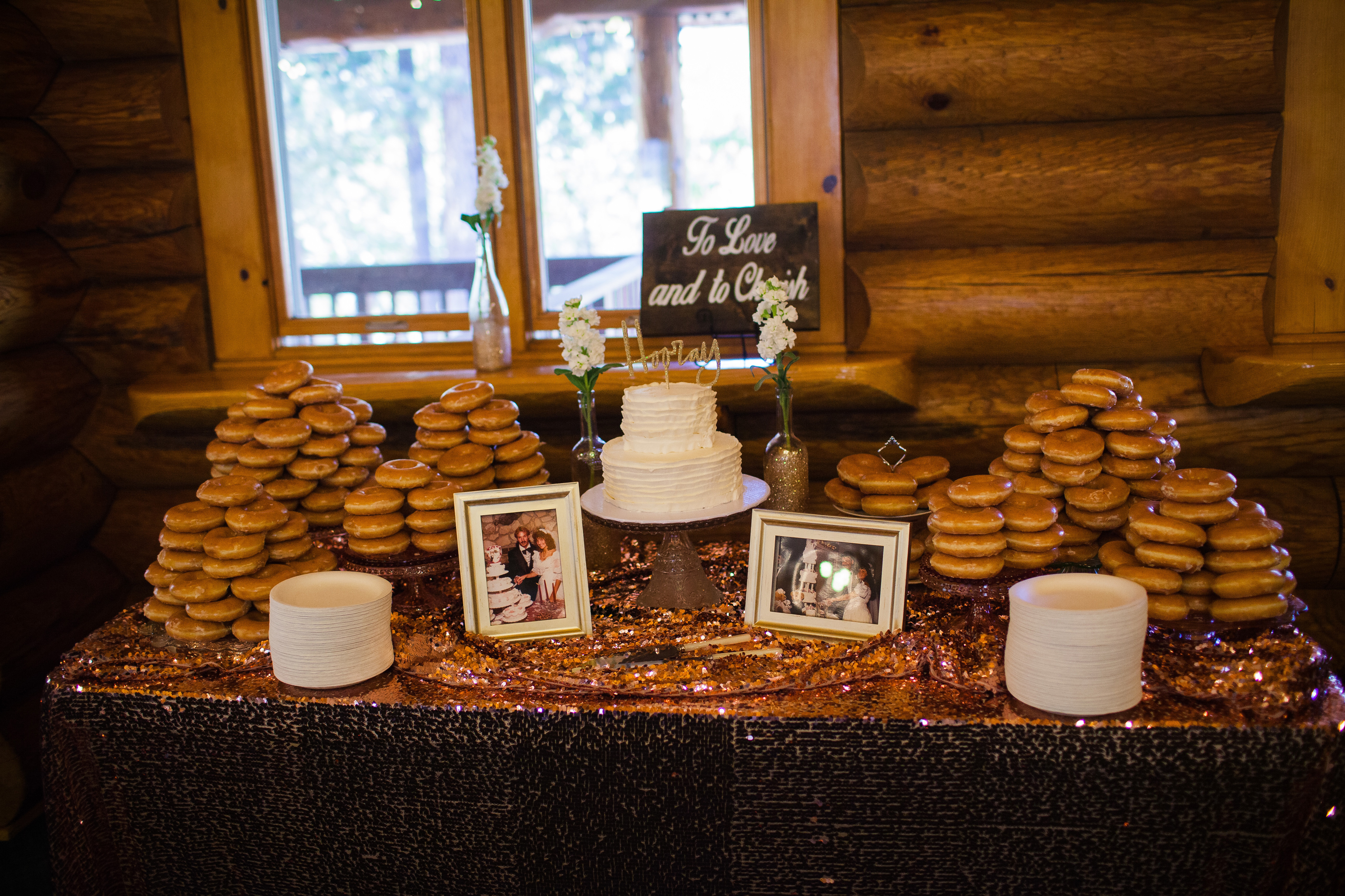 The Wedding Cake And Towers Of Scrumptious Glazed Doughnuts Were Displayed On A Glam Sequined