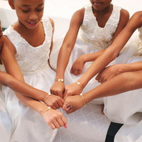 Flower Girls Showing Off Bracelets